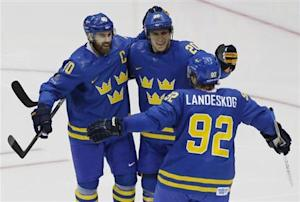 Sweden's Zetterberg celebrates his goal with teammates Steen and Landeskog during the second period of their men's preliminary round hockey game against the Czech Republic at the Sochi 2014 Winter Olympic Games