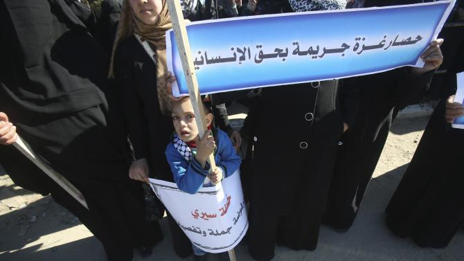 Palestinian boy takes part in a protest against the blockade and also calling for reconstructing Gaza, in Khan Younis in the southern Gaza Strip