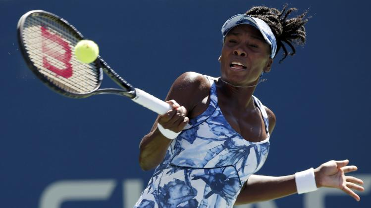 Venus Williams of the U.S. hits a return to Sara Errani of Italy during their match at the 2014 U.S. Open tennis tournament in New York