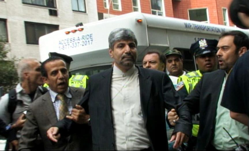In this image taken from video obtained by AP Television, Iranian Deputy Foreign Ministry spokesman Ramin Mehmanparast, right, is escorted from the street near the United Nations headquarters after being involved in a scuffle with a small crowd, Wednesday, Sept. 26, 2012 in New York. (AP Photo/Monica Gutierrez)
