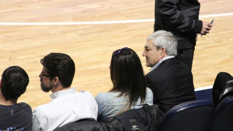 Former Penn State president Graham Spanier, right, watches the Penn State men's basketball game against Nebraska, Saturday, Jan. 19, 2013 at the Bryce Jordan Center in State College, Pa. (AP Photo/StateCollege.com, Ben Jones)