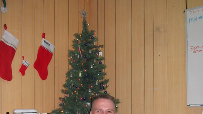 This Dec. 15, 2006 photo provided by Brock McNabb shows Pete Linnerooth in their Christmas-decorated office in Baghdad, Iraq. Capt. Linnerooth, an Army psychologist, counseled soldiers during some of the fiercest fighting in Iraq. (AP Photo/Brock McNabb)