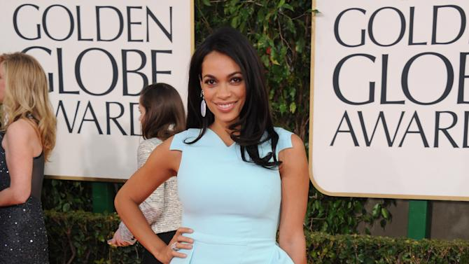 Actress Rosario Dawson arrives at the 70th Annual Golden Globe Awards at the Beverly Hilton Hotel on Sunday Jan. 13, 2013, in Beverly Hills, Calif. (Photo by Jordan Strauss/Invision/AP)