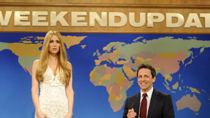 """This image released by NBC shows Kristen Wiig, portraying singer Lana Del Rey, left and Seth Meyers during a skit from """"Saturday Night Live."""" Wiig was nominated for an Emmy award on Thursday, July 19, 2012 for her various roles on """"Saturday Night Live."""" The 64th annual Primetime Emmy Awards will be presented Sept. 23 at the Nokia Theatre in Los Angeles, hosted by Jimmy Kimmel and airing live on ABC. (AP Photo/NBC,Dana Edelson)"""
