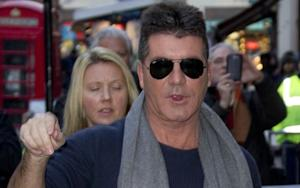 Simon Cowell Is Having a Baby With His Friend's Wife