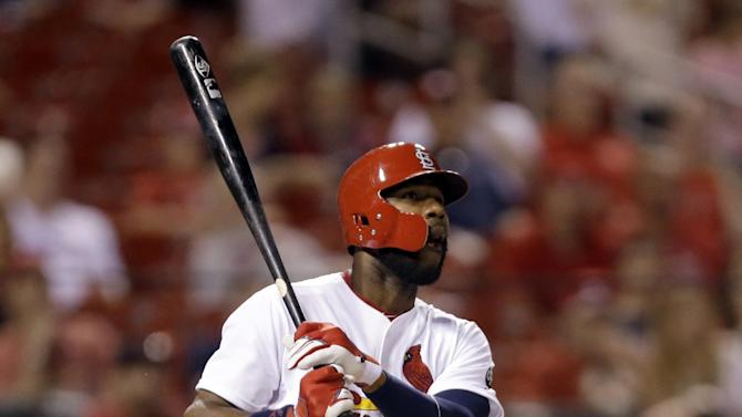 St. Louis Cardinals' Jason Heyward watches his solo home run during the ninth inning of a baseball game against the Arizona Diamondbacks Wednesday, May 27, 2015, in St. Louis. (AP Photo/Jeff Roberson)