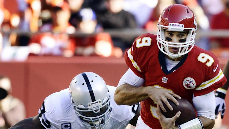 "Kansas City Chiefs quarterback Brady Quinn (9) is tackled by Oakland Raiders defensive tackle Tommy Kelly (93) during the first half of an NFL football game at Arrowhead Stadium in Kansas City, Mo., Sunday, Oct. 28, 2012. Quinn left the game during the first quarter due to what the team called a ""head injury."" (AP Photo/Reed Hoffmann)"