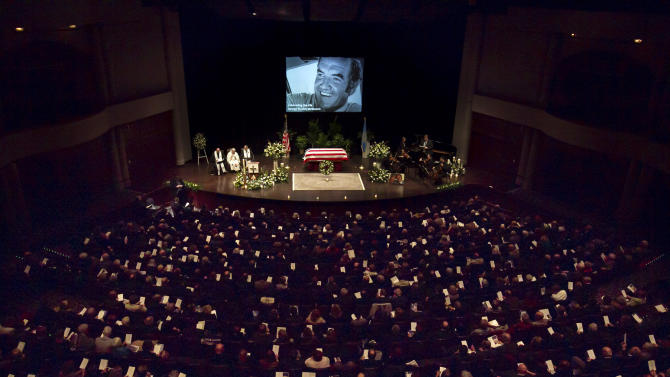 Mourners fill the hall at a funeral service for former Democratic U.S. Senator and three-time presidential candidate George McGovern at the Washington Pavilion of Arts and Science in Sioux Falls, S.D., Friday, Oct. 26, 2012. McGovern died Sunday in his native South Dakota at age 90. (AP Photo/Nati Harnik, Pool)