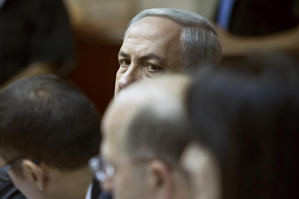 Israeli Prime Minister Benjamin Netanyahu looks over the heads of cabinet ministers as he chairs the weekly cabinet meeting in his Jerusalem offices, Sunday, Oct. 14, 2012. Israel's Cabinet announced January 22, 2013 as the date for parliamentary elections, with Prime Minister Benjamin Netanyahu leading in the polls. (AP Photo/Jim Hollander, Pool)