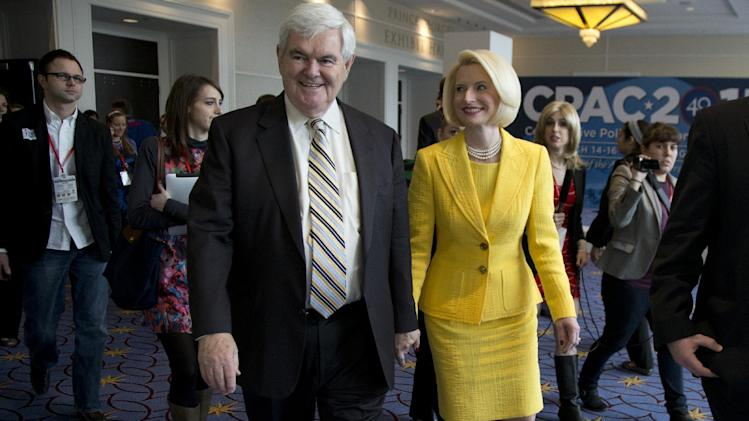 Former House Speaker Newt Gingrich and his wife Callista Gingrich walk from the exhibition hall at the 40th annual Conservative Political Action Conference in National Harbor, Md., Saturday, March 16, 2013. (AP Photo/Carolyn Kaster)
