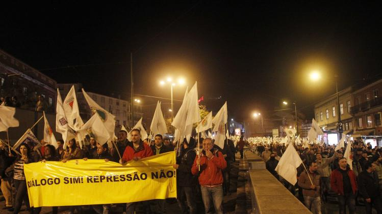 Demonstrators march during a protest in Lisbon