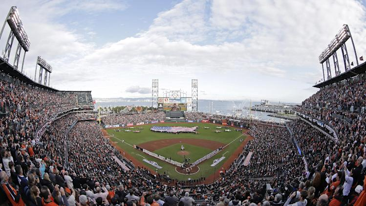 In this photo shot with a fisheye lens, Phillip Phillips sings the national anthem before the start of Game 1 of baseball's World Series between the San Francisco Giants and Detroit Tigers Wednesday, Oct. 24, 2012, in San Francisco. (AP Photo/Darron Cummings)