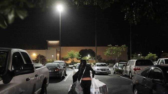 Two customers walk with their purchased items after shopping at a Kohl's department store in La Habra, Calif., Friday, Nov. 25, 2011. Thousands of shoppers lined up at Macy's, Best Buy and other stores nationwide to buy everything from toys to tablets on Black Friday despite the economic downturn and some planned protests of the shopping holiday. (AP Photo/Jae C. Hong)