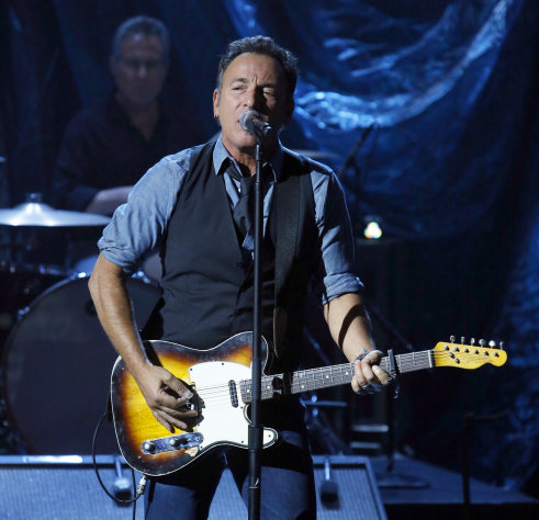 "In this photo provided by NBC, Bruce Springsteen performs during ""Hurricane Sandy: Coming Together"" Friday, Nov. 2, 2012, in New York. Hosted by Matt Lauer, the event is heavy on stars identified with New Jersey and the New York metropolitan area, which took the brunt of this week's deadly storm. (AP Photo/NBC, Heidi Gutman)"