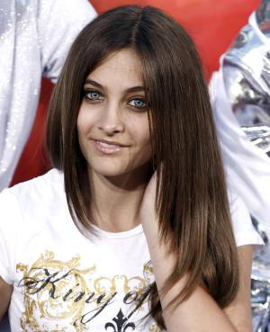 FILE - This Jan. 26, 2012 file photo shows Paris Jackson, daughter of the late pop icon Michael Jackson, during the hand and footprint ceremony honoring her father at Grauman's Chinese Theatre in Los Angeles. Jackson is physically fine after being taken to a hospital early Wednesday, June 5, 2013, an attorney for Jackson's mother said. Perry Sanders Jr. writes in a statement that Paris Jackson is getting appropriate medical attention and the family is seeking privacy. Fire and sheriff's officials confirmed they transported someone from a home in Paris' suburban Calabasas neighborhood for a possible overdose but did not release any identifying information or additional details. (AP Photo/Matt Sayles, file)
