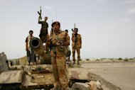 Yemeni army troops patrol the road between Zinjibar and Jaar. More than 50 civilians and 23 military personnel have been killed by mines sown by Al-Qaeda since the militants were chased out of areas of south Yemen on June 13, the defence ministry says