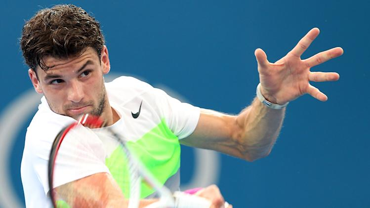 Grigor Dimitrov of Bulgaria plays a shot in his semi final match against Marcos Baghdatis of Cyprus during the Brisbane International tennis tournament in Brisbane, Australia, Saturday, Jan. 5, 2013.  (AP Photo/Tertius Pickard).
