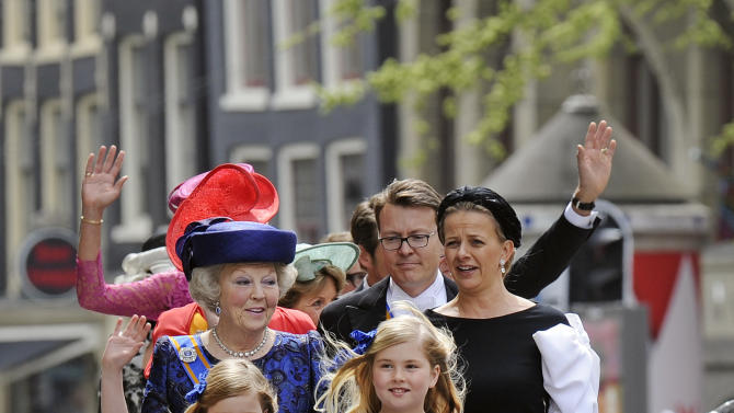 Dutch Princess Beatrix arrives with her granddaughters  Alexia, Catharina-Amalia and Ariane, from left, at the Nieuwe Kerk or New Church in Amsterdam, The Netherlands,  for the inauguration of King Willem-Alexander Tuesday April 30, 2013. Around a million people are expected to descend on the Dutch capital for a huge street party to celebrate the first new Dutch monarch in 33 years. (AP Photo/Toussaint Kluiters, Pool)