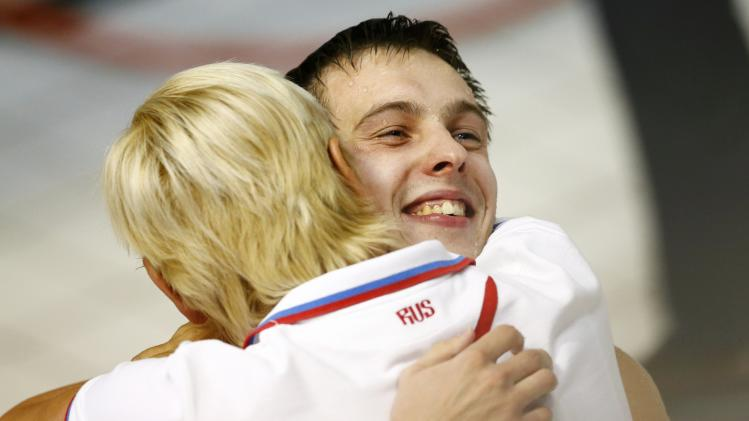 Minibaev of Russia celebrates with unidentified team member after winning in the men's 10m platform final at the European Swimming Championships in Berlin