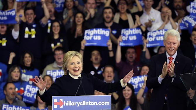 Democratic presidential candidate Hillary Clinton speaks as former President Bill Clinton applauds at her New Hampshire presidential primary campaign rally, Tuesday, Feb. 9, 2016, in Hooksett, N.H. (AP Photo/Elise Amendola)