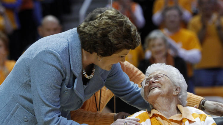 Tennessee head coach emeritus Pat Summitt hugs her mother Hazel Head after a banner in Summitt's honor was raised before an NCAA college basketball game between the Tennessee and the Notre Dame on Monday, Jan. 28, 2013, in Knoxville, Tenn. (AP Photo/Wade Payne)