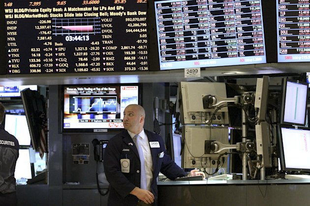 FILE- In this Thursday, June 21, 2012 file photo, a trader works on the floor of the New York Stock Exchange in New York. Wall Street appeared headed for a higher opening, Friday June 22, 2012 a day a