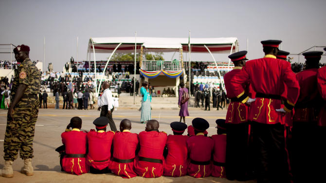 Members of the Southern Sudanese national marching band await the start of the formal declaration of independence in the capital city of Juba on Saturday, July 9, 2011. The southern Sudanese opted for secession during a popular referendum in January 2011. Saturday's declaration and recognition makes the Republic of South Sudan the world's 193rd country.   (AP Photo/Pete Muller)