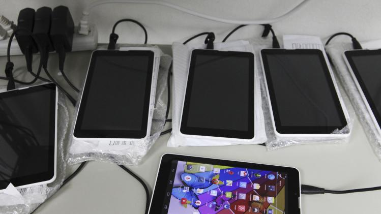 New Android-based tablets assembled from imported components are charged at the Surtab factory in Port-au-Prince