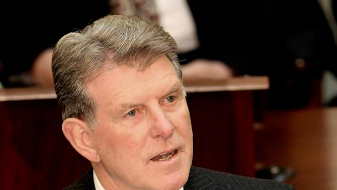 "FILE - This Jan. 9, 2012 file photo shows Idaho Gov. C.L. ""Butch"" Otter delivering his State of the State address inside the House chambers at the Idaho Statehouse in Boise, Idaho. At least 20 states have turned down the Obama administration's invitation to run new health insurance markets that will be serving millions of uninsured Americans in less than a year. That means the Feds will step in and operate the programs, a defining challenge for President Barack Obama's second term. Otter supports a state run health exchange.  (AP/Photo Matt Cilley, File)"