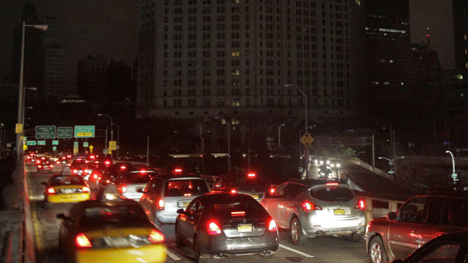Early morning commuters cross New York's Brooklyn Bridge, Wednesday, Oct. 31, 2012. Morning rush-hour traffic appeared thicker than on an ordinary day as people started to return to work in a New York without functioning subways. Cars were bumper-to-bumper on several major highways. (AP Photo/Richard Drew)