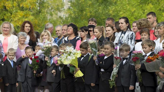 Children, going to the first grade, line up during an event to mark the upcoming start of another school year in Minsk, Belarus