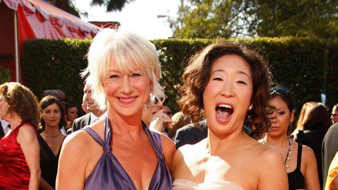Helen Mirren and Sandra Oh arrive at the 59th Annual Primetime Emmy Awards at the Shrine Auditorium on September 16, 2007 in Los Angeles, California.