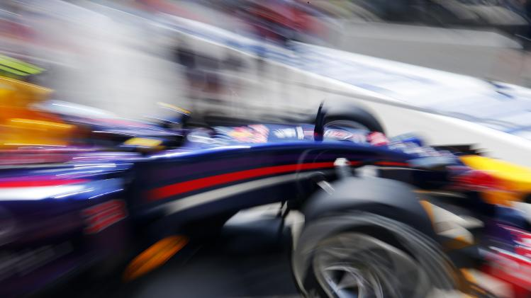 Red Bull Formula One driver Ricciardo of Australia leaves his garage during the third free practice session of the Hungarian Grand Prix at the Hungaroring circuit
