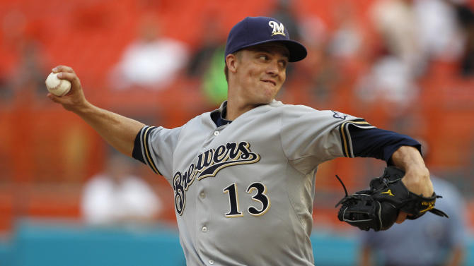 Milwaukee Brewers starting pitcher Zack Greinke (13) throws in the first inning during a baseball game against the Florida Marlins in Miami, Monday, June 6, 2011. (AP Photo/Lynne Sladky)