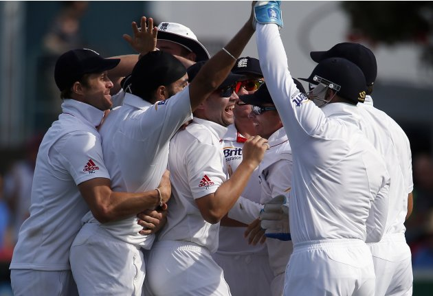 England's Bell celebrates with team after he caught New Zealand's Rutherford for 15 runs during the third day of the second test in Wellington