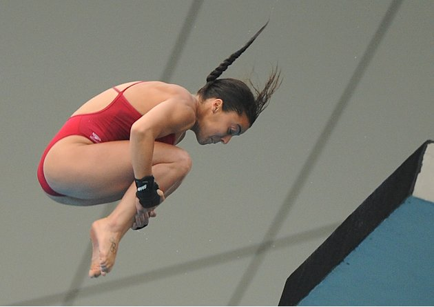 Canada's Meaghan Benfeito competes in the women's 10-metre platform final diving event in the FINA World Championships at the outdoor diving pool of the Oriental Sports Center, in Shanghai, on July 21