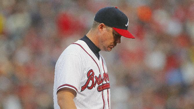 Atlanta Braves third baseman Chipper Jones reacts after his throwing error during the fourth inning of the National League wild card playoff baseball game against the St. Louis Cardinals, Friday, Oct. 5, 2012, in Atlanta. (AP Photo/Todd Kirkland)