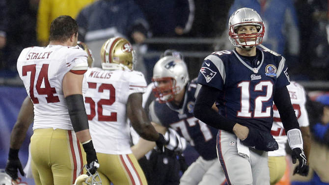 New England Patriots quarterback Tom Brady (12) walks toward the sideline in the second quarter of an NFL football game against the San Francisco 49ers in Foxborough, Mass., Sunday, Dec. 16, 2012. (AP Photo/Elise Amendola)