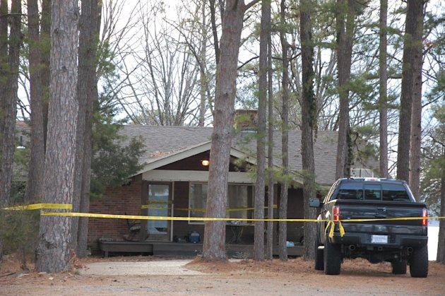 Yellow crime-scene tape blocks off the home of Mindy McCready in Heber Springs, Ark., on Monday, Feb. 18, 2013, the day after the country singer was found dead there Sunday in an apparent suicide. She was 37. (AP Photo/Jeannie Nuss)