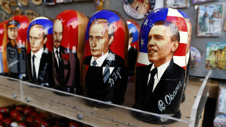 A traditional Russian Matryoshka wooden doll depicting US President Barack Obama, right, Russian President Vladimir Putin, second from right, U.S. President George W. Bush, second from left, Leader of the Soviet Union from the mid-1920's until 1953 Joseph Stalin, left, and Vladimir Ilyich Lenin leader of the Russian Soviet Federative Socialist Republic from 1917 on a display in Tallinn, Estonia, Tuesday, Sept. 2, 2014 (AP Photo/Mindaugas Kulbis)