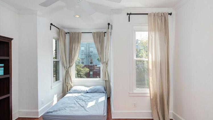 Photo tour: An ultra-narrow house in D.C. bigger bedroom facing window
