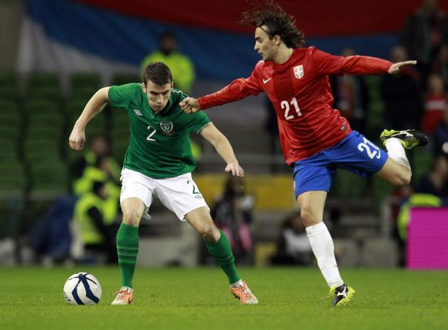 Ireland's Coleman fights for the ball with Serbia's Markovic during their international friendly soccer match at the Aviva Stadium in Dublin
