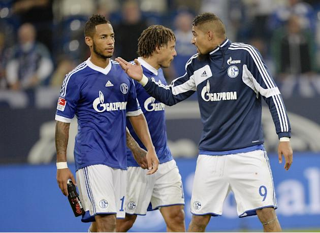 Schalke's Kevin-Prince Boateng of Ghana, right, talks to Dennis Aogo, left, after losing the German soccer Bundesliga match between FC Schalke 04 and Bayern Munich at the arena in Gelsenkirchen, Germa