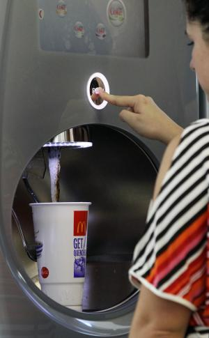 Christina Nunez fills up a supersized soft-drink cup with cola at a fast-food restaurant in New York, Thursday, Sept. 13, 2012.  The era of the supersized cola may come to an end in New York City on Thursday, when health officials are expected to approve an unprecedented 16-ounce (470-milliliter) limit on sodas and other sugary drinks at restaurants, delis and movie theaters.  Nunez says she drinks an extra large drink every day after work. (AP Photo/Kathy Willens)