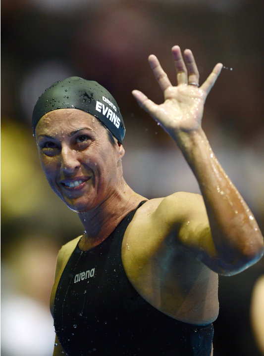 Janet Evans waves to the crowd after swimming in the women's 400-meter freestyle preliminaries at the U.S. Olympic swimming trials, Tuesday, June 26, 2012, in Omaha, Neb. (AP Photo/Mark J. Terrill)