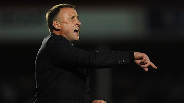 Mark Yates' Cheltenham take on Everton on Monday
