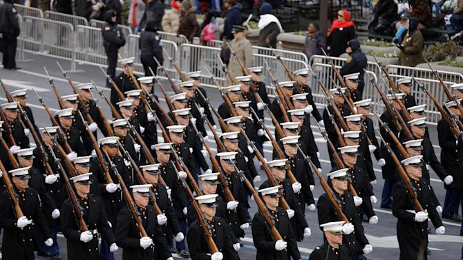 Members of the United States Marine Corps march during the 57th Presidential Inaugural Parade on Pennsylvania Avenue, Monday, Jan. 21, 2013 in Washington. Thousands marched during the 57th Presidential Inauguration parade after the ceremonial swearing-in of President Barack Obama. (AP Photo/Alex Brandon)