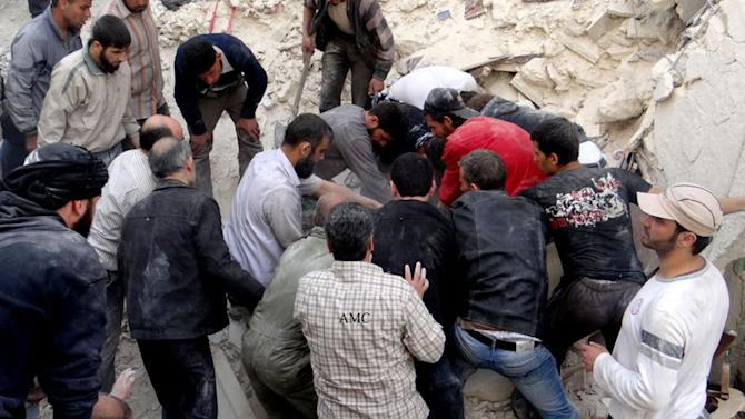 This citizen journalism image taken on Sunday, April 7, 2013 provided by Aleppo Media Center AMC which has been authenticated based on its contents and other AP reporting, shows Syrian citizens searching for bodies in the rubble of damaged buildings that were attacked by Syrian forces airstrikes, in the al-Ansari neighborhood of Aleppo, Syria. More than 70,000 people have died since Syria's crisis erupted in March 2011. The Syria-based Violations Documentation Center says nearly 9,000 government troops have been killed in two years of fighting between President Bashar Assad's forces and rebels trying to topple him. (AP Photo/Aleppo Media Center AMC)