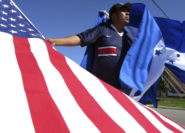 A vendor sells American and Honduras flags before their 2014 World Cup qualifying soccer match in Salt Lake City, Utah