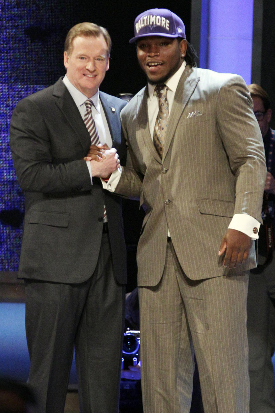 Alabama defensive end Courtney Upshaw poses for photographs with NFL Commissioner Roger Goodell after being selected 35th overall by the Baltimore Ravens in the second round of the NFL football draft at Radio City Music Hall, Friday, April 27, 2012, in New York. (AP Photo/Frank Franklin II)